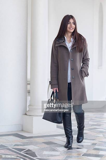Fashionable Brunette Businesswomen Walking Outdoor on City Street