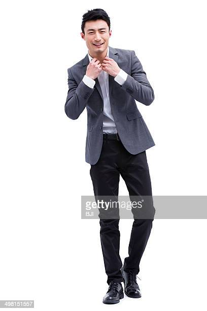 fashionable businessman adjusting neckline - open collar stock pictures, royalty-free photos & images