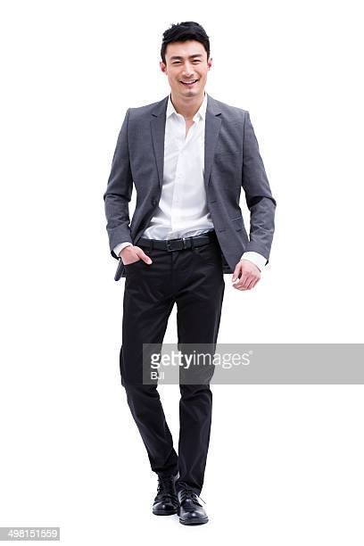 fashionable businessman on the move - colletto aperto foto e immagini stock