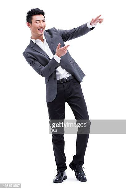 Fashionable businessman pointing away