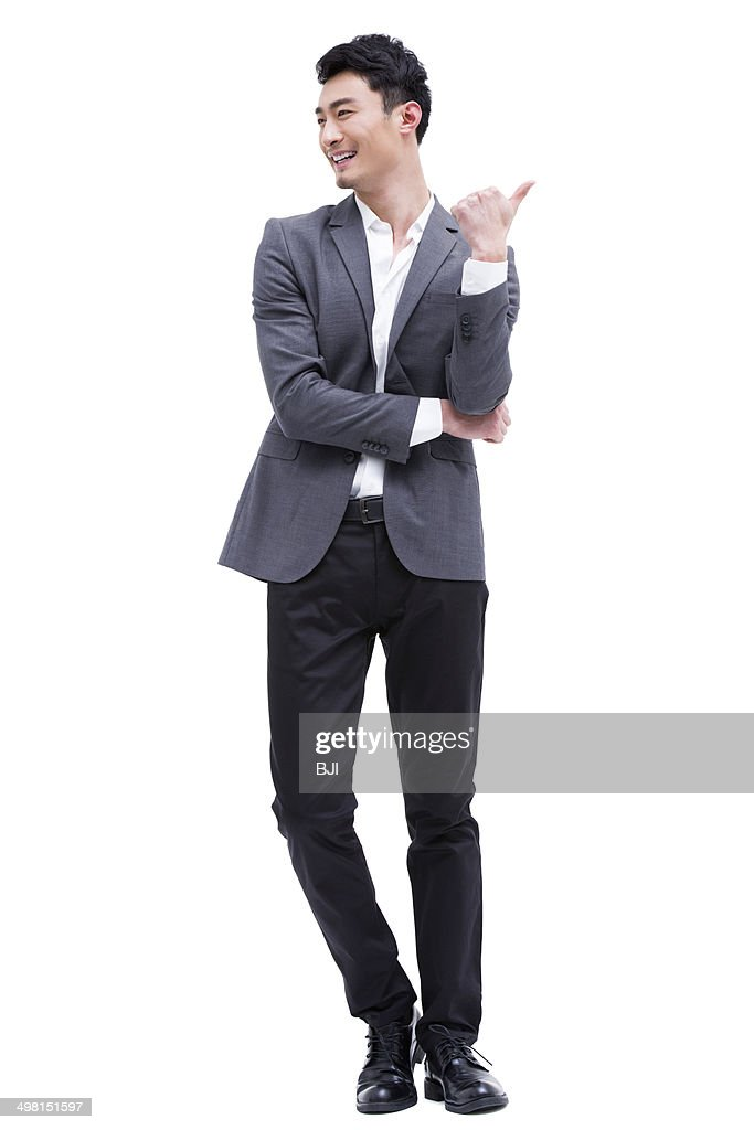 Fashionable businessman pointing away : Stock Photo