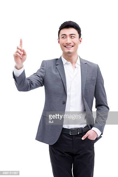 Fashionable businessman raising finger up