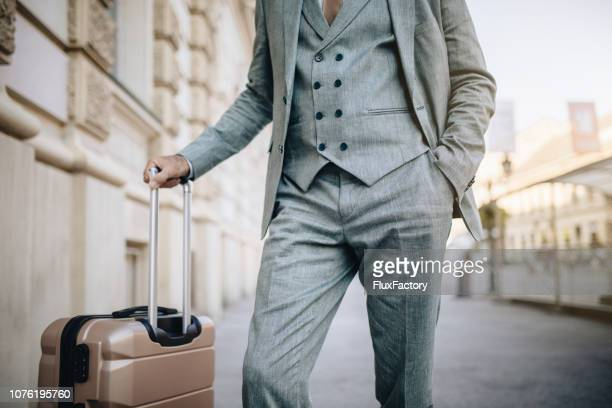 fashionable businessman with a suitcase - waistcoat stock photos and pictures