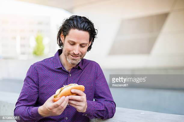Fashionable businessman with Hot Dog