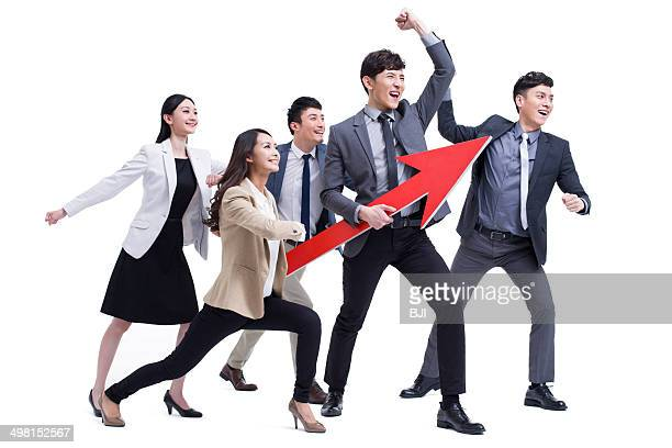 Fashionable businessperson punching the air with red arrow sign