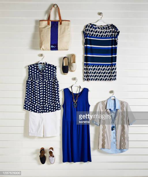 fashionable clothing on coathanger - womenswear stock pictures, royalty-free photos & images