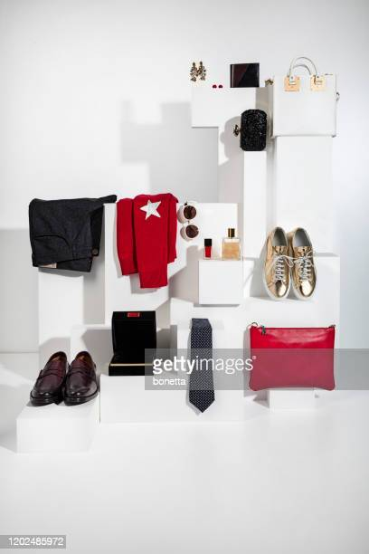 fashionable clothing with personal accesories - gold shoe stock pictures, royalty-free photos & images