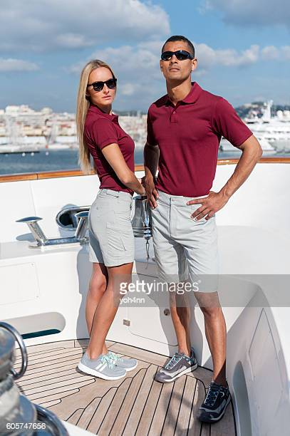 fashionable cool couple on luxury yacht - polo shirt stock pictures, royalty-free photos & images