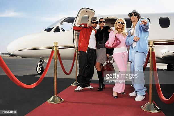 Fashionable couples with private airplane