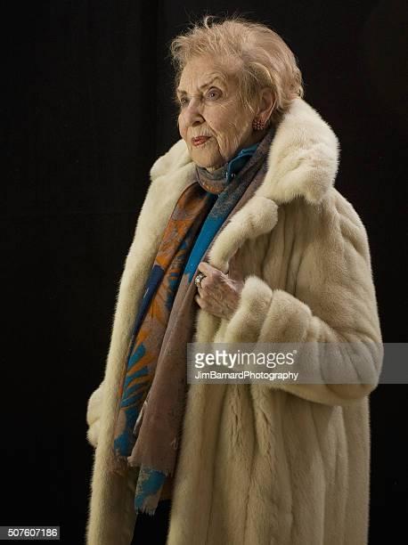 Fashionable Elderly Woman in Fur Coat