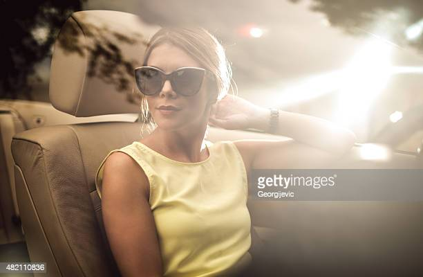 fashionable female driver - fashion showroom stock pictures, royalty-free photos & images