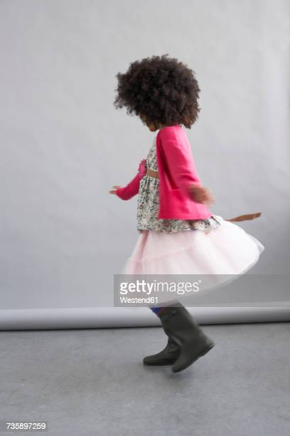 Fashionable girl dancing