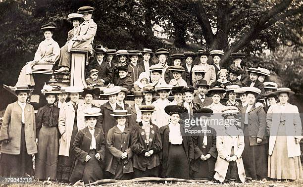 Fashionable group of people on a charabanc outing, wearing their Sunday best, circa 1895.