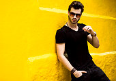 fashionable handsome man isolated on yellow wall