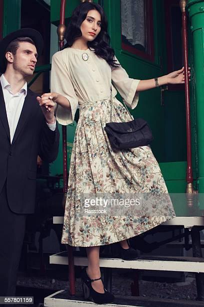Fashionable lady disembarking train car