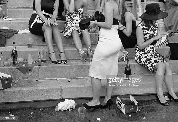 Fashionable lady punters enjoy the atmosphere and drinks before a race at Epsom, June 2007. Epson Downs Racecourse is where the iconic Derby Festival...