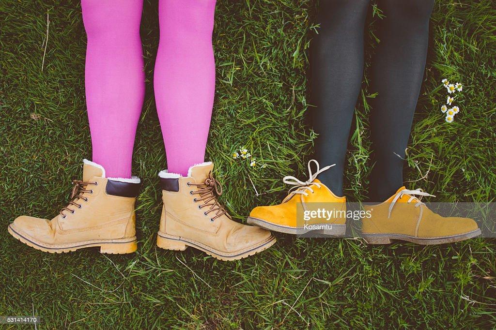 Fashionable legs in flowery field : Stock Photo