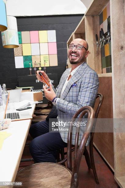 fashionable man at meeting - working stock pictures, royalty-free photos & images