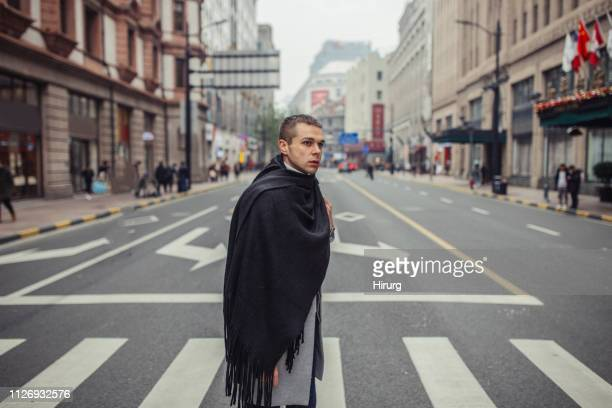 fashionable man crossing the street - neckwear stock pictures, royalty-free photos & images