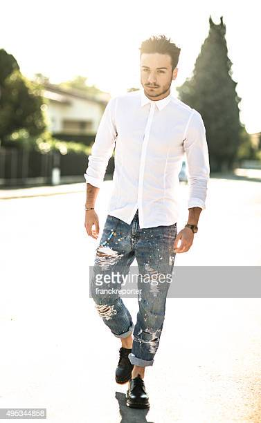 fashionable man on the street at dusk - all hip hop models stock photos and pictures