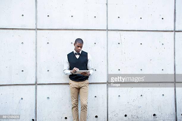 Fashionable man using digital tablet
