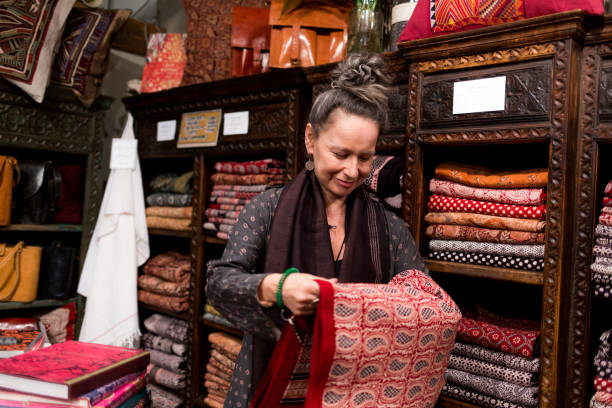 Fashionable older woman organizing merchandise