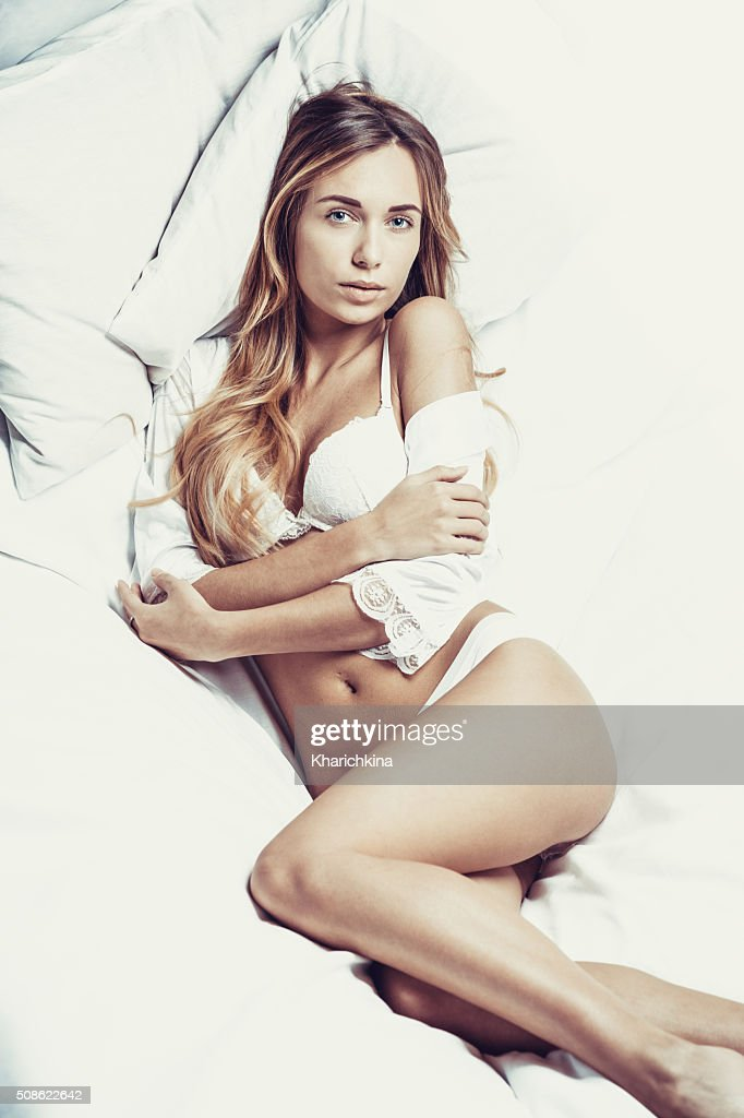 Fashionable photo of young sexy lady wearing white lingerie : Stock Photo
