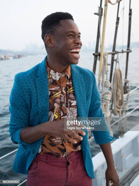 fashionable portrait on sailboat - multi colored blazer stock photos and pictures