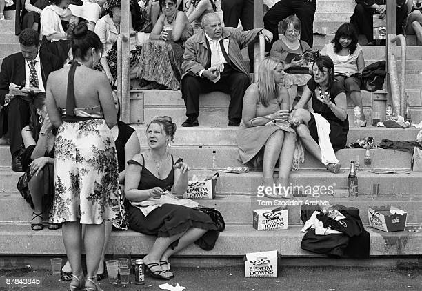 Fashionable punters enjoy the atmosphere and drinks before a race at Epsom, June 2007. Epson Downs Racecourse is where the iconic Derby Festival...