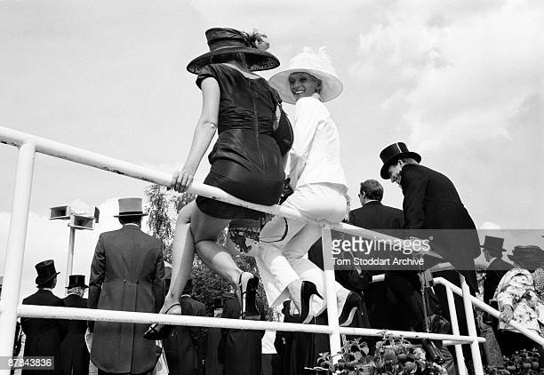 Fashionable punters watch the horses parade before a race at Epsom, June 2007. Epson Downs Racecourse is where the iconic Derby Festival dating back...