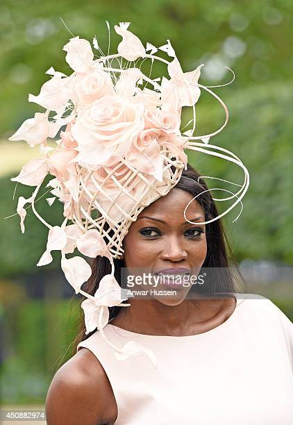 A fashionable racegoer attends Ladies Day at Royal Ascot on June 19 2014 in Ascot England