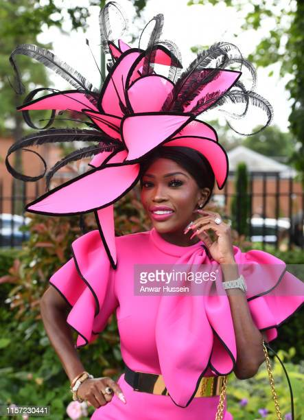 Fashionable racegoer attends Ladies Day at Royal Ascot on June 20, 2019 in Ascot, England.