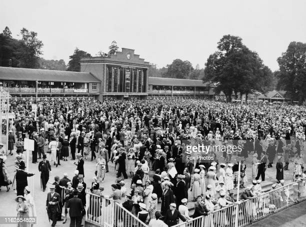 Fashionable racegoers in morning dress top hat and tails in the Tote Building enclosure for the Royal Ascot race meeting on 19th June 1957 at Ascot...