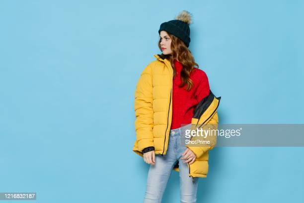 fashionable red-haired woman in a bright youth winter jacket coat. - 防寒着 ストックフォトと画像
