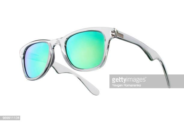 fashionable sunglasses with green lenses. isolated on white background - sunglasses stock pictures, royalty-free photos & images