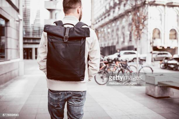Fashionable Tourist with a Backpack on the Street Traveling in Europe