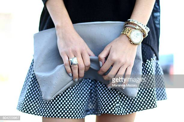 fashionable woman holding a clutch - accessoires stock-fotos und bilder