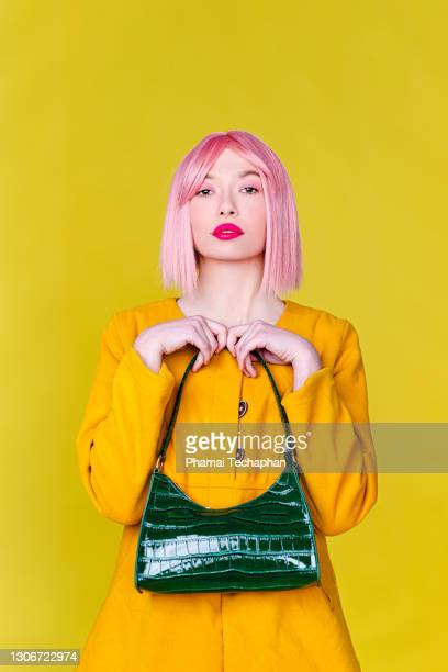 fashionable woman holding handbag - pink purse stock pictures, royalty-free photos & images