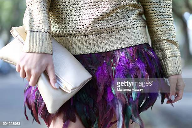 fashionable woman in a feather skirt - pochette borsetta foto e immagini stock