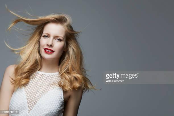 fashionable woman in a white dress - カクテルドレス ストックフォトと画像