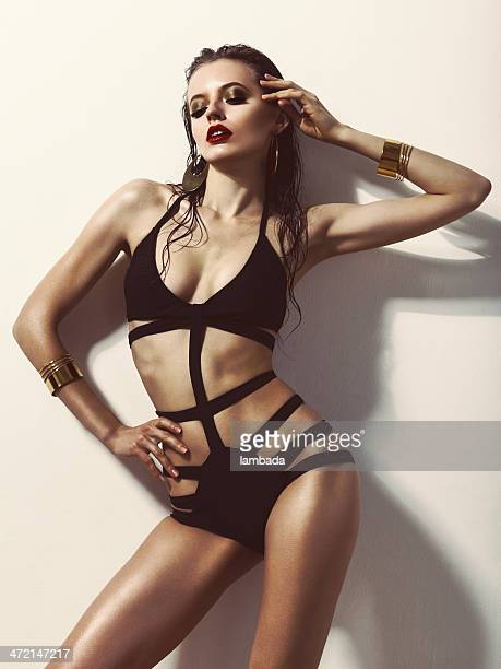 Fashionable woman in black swimsuit