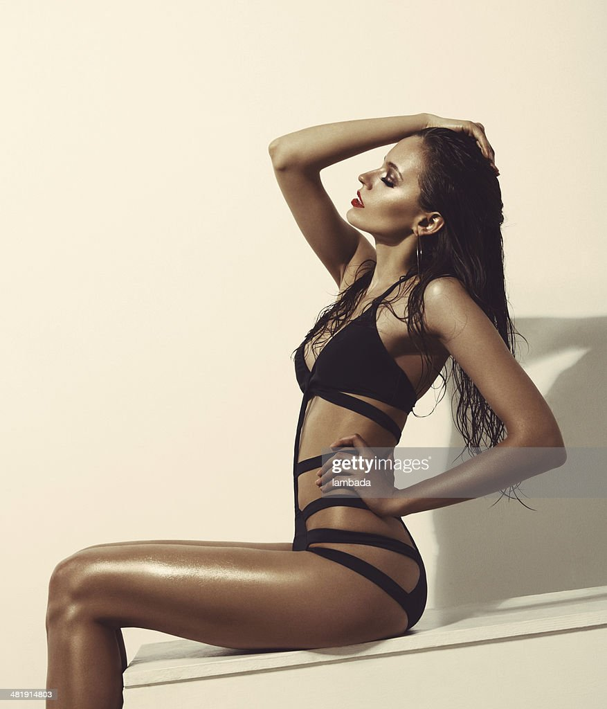 Fashionable woman in black swimsuit : Stock Photo