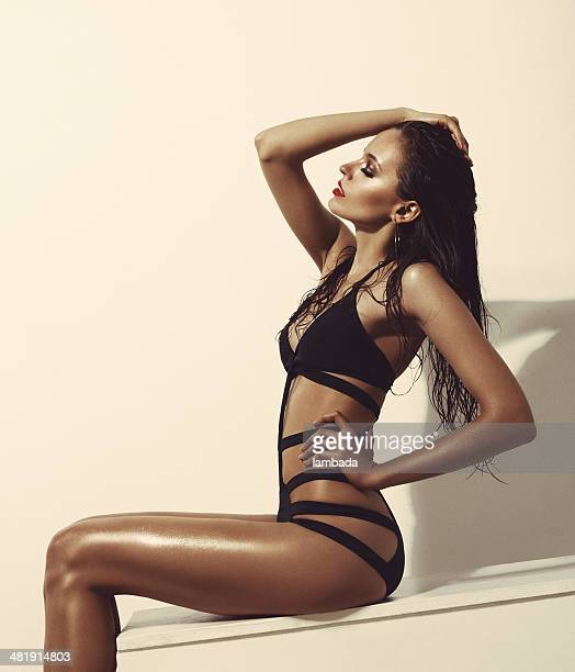 fashionable woman in black swimsuit - beautiful long legs stock pictures, royalty-free photos & images