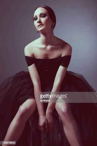 Fashionable woman in elegant black dress
