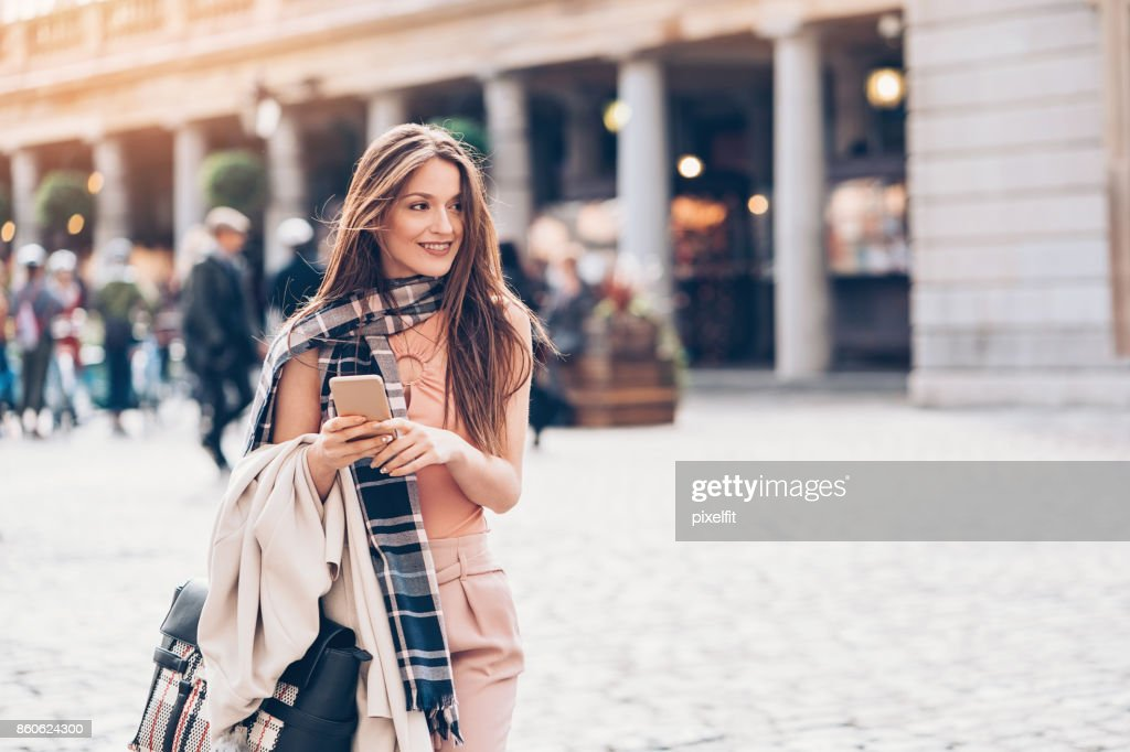 Fashionable woman in London city : Stock Photo