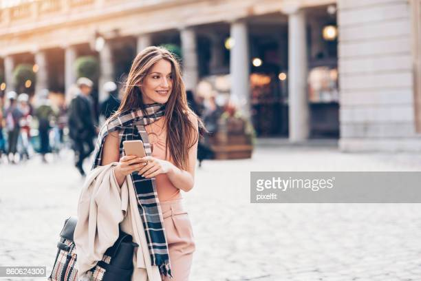 fashionable woman in london city - fashionable stock pictures, royalty-free photos & images