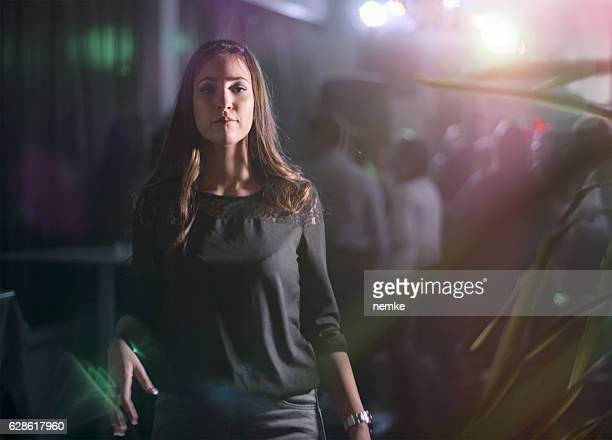 Fashionable woman in nightclub
