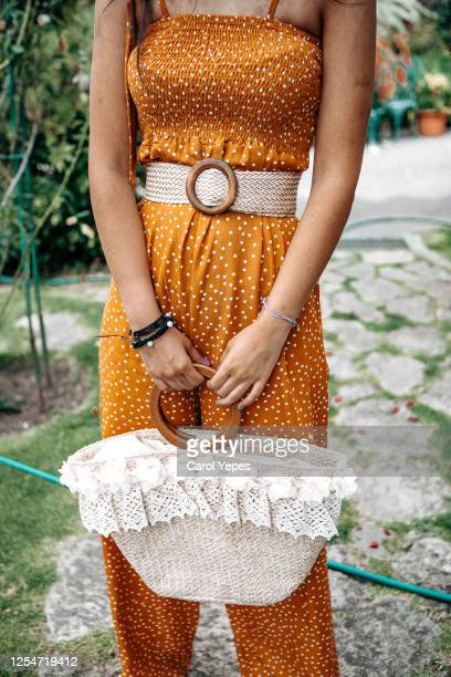fashionable woman in summer yellow dress and straw bag outdoors - womenswear stock pictures, royalty-free photos & images