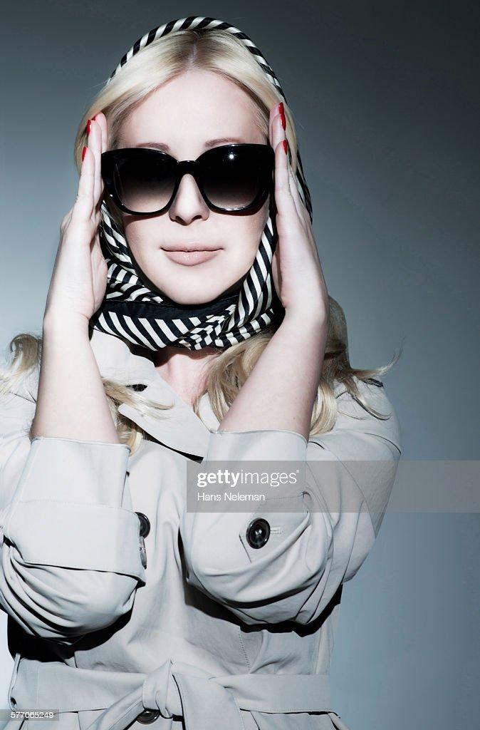 Fashionable woman posing in studio