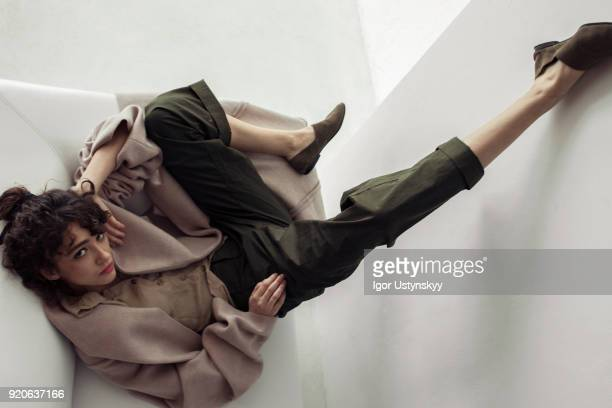 Fashionable woman raising leg